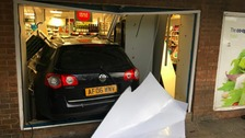 The car was left in the front of the shop as the culprits got away in a second car.