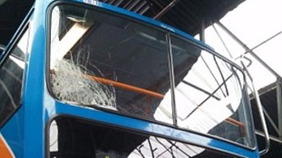 Smashed bus window