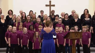 The two choirs got together at a charity concert
