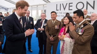 Prince Harry speaks with members of the Brigade of Gurkhas during the reception.