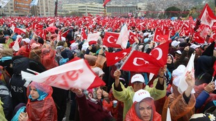 People show their support for President Erdogan during a speech on Monday.