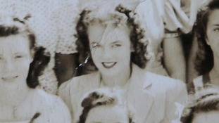 A copy of the school photo of Marilyn Monroe (centre), known then as Norma Jean Dougherty.