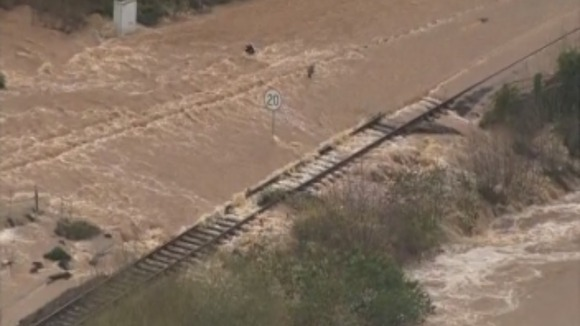 Rail tracks are flooded as the flooding seeps its banks.