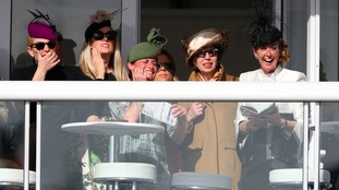 Zara Phillips and Princess Anne enjoy the racing from the royal enclosure.