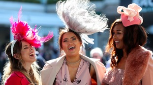 Three ladies flaunt some extravagant looking head-wear at the Cheltenham Festival.