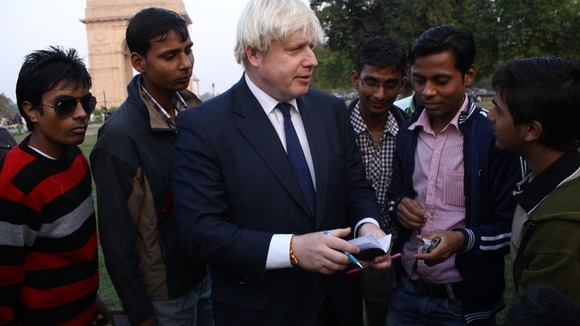 London Mayor Boris Johnson signing autographs near India Gate.