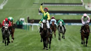 Jockey Robbie Power celebrates after his winning ride on Sizing John.