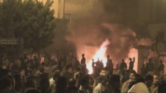 Protesters in the Egyptian city of Damanhour gather around a large fire