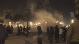 Police in riot gear fire tear gas canisters at demonstrators in Damanhour