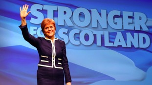 First Minister and SNP leader Nicola Sturgeon waves during the SNP Spring Conference