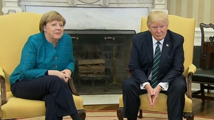 President Trump appears to ignore Chancellor Merkel's offer of a handshake in the Oval Office