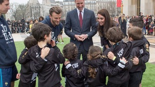 William and Kate speaking to some young rugby players