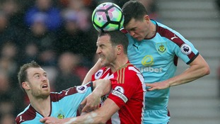 Sunderland's John O'Shea battles with Burnley's Ashley Barnes (left) and Michael Keane
