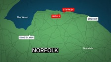 A couple and their dogs had to be rescued from the north Norfolk coast.