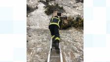 Firefighter climbs up chalk pit