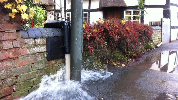 Pumping water out of a 16th century cottage in Kempsey, Worcestershire 