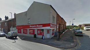 Police investigating knifepoint robbery at Bargain Booze store