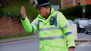 Bobby on the beat...Police officer directing traffic at Cheltenham Festival goes viral