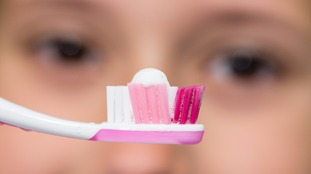 File photo of tooth brush with paste on.