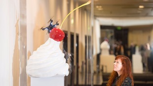 Whirl of cream and syrup can sculpture to top fourth plinth