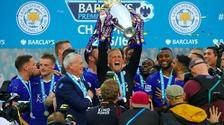 Kasper Schmeichel lifting the Premier League trophy