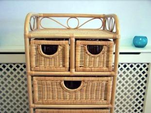 Smiling wicker storage unit