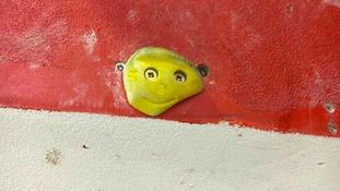 Smiling climbing wall grip