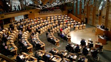 The debate in the Holyrood chamber has been suspended.