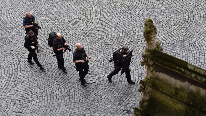Armed police arrive at the scene outside the Palace of Westminster