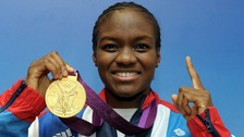 Nicola Adams with her gold medal won in the boxing 51kg category at Team GB house in London.