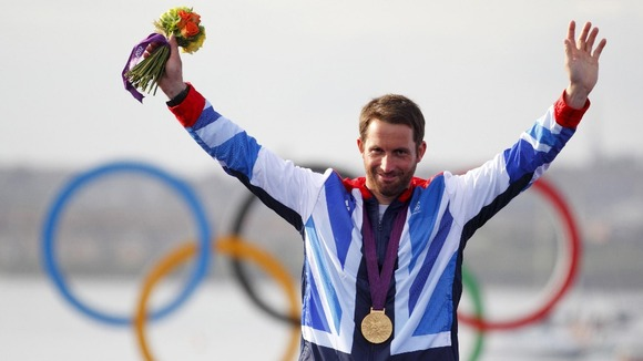 Ben Ainslie celebrating his fourth Olympic gold medal at the sailing venue in Portland.