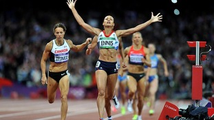 Jessica Ennis celebrates winning gold in the Women's Heptathlon after finishing the 800m at the Olympic Stadium.