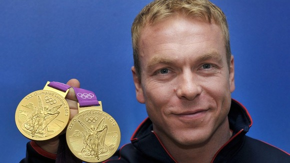 Sir Chris Hoy with his two Gold medals during a photocall at team GB House, London.