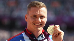 David Weir with his gold medal after winning the Men's 5000m - T54 at the Olympic Stadium, London.