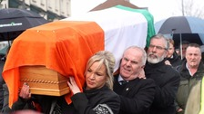 Martin McGuinness's coffin was carried to his home in Londonderry on Tuesday