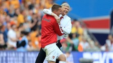 Lukas Podolski celebrates with manager Arsene Wenger