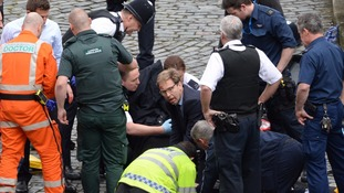 MP Tobias Ellwood (c) helped the emergency services on Wednesday
