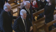 Former US president Bill Clinton and former taoiseach Bertie Ahern arrive for the funeral.