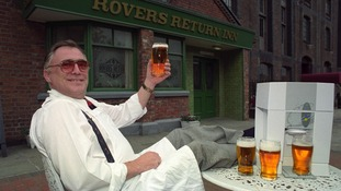 Actor Bill Tarmey, aka Coronation Street's Jack Duckworth, raises a pint outside the Rovers Return