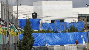 Blue sheets were placed over Yasser Arafat's mausoleum ahead of the exhumation