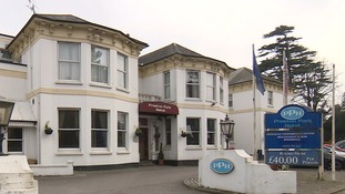 Hotel staff said he checked in and out of the £40-a-night hotel without any suspicion.