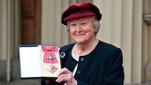 Dame Patricia with her medal outside Buckingham Palace.