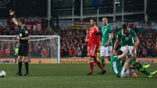 Republic of Ireland's Seamus Coleman holds his leg after a challenge from Wales' Neil Taylor