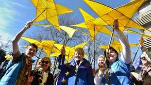 A group hoist the EU stars above their heads