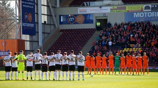 Players stand for a minutes silence in memory of the victims of the London Terror Attacks before the Irn Bru-Cup Final at Fir Park, Motherwell.