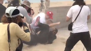 Fights broke out at the rally on Huntington beach