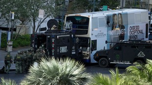 Las Vegas bus siege: Gunman surrenders after fatal shooting shuts down famous casino strip