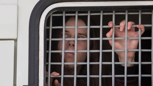 A detained woman was among Alexei Navalny's supporters to be held in a police van.