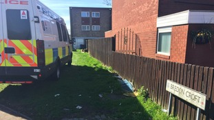 An unmarked van and a West Midlands Police van were parked close to the searched property.