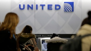 Women at a United check-in desk